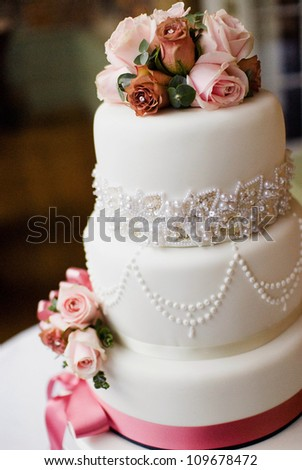 A traditional and decorative wedding cake at wedding reception. - stock photo