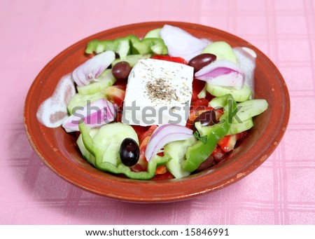 A traditional greek or country salad served at a greek taverna - stock photo