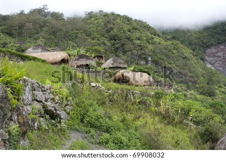A traditional hut in an Indonesian mountain village - stock photo