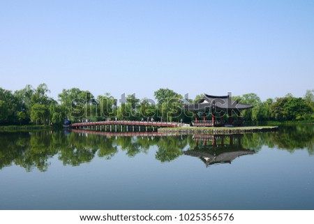 a traditional Koean pavilion in the lake