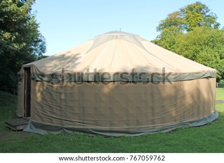 A Traditional Large Round Canvas Yurt Tent Shelter. & Old Fashioned White Canvas Bell Camping Stock Photo 85443778 ...
