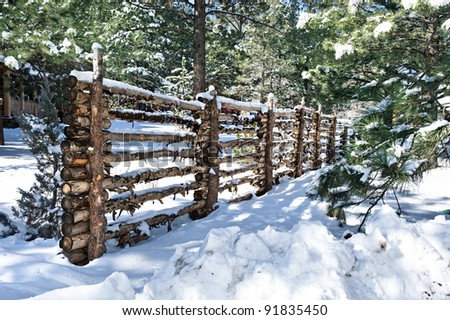 A traditional log fence defines the boundaries of private property. - stock photo