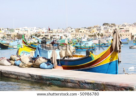 a traditional maltese fishing boat in the fishing village of marsaxlokk on the maltese islands - stock photo