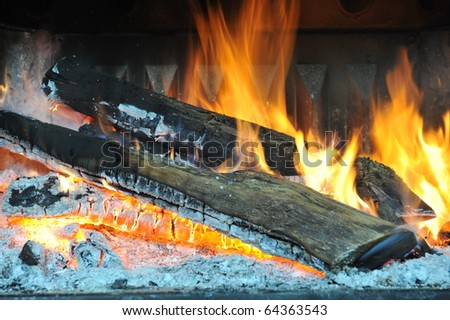 A traditional open log fire. - stock photo