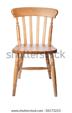 A traditional pine kitchen chair isolate on white - stock photo