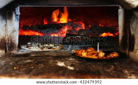 A traditional pizza oven made consisting of a baking chamber made of fireproof brick, clay, stones and concrete. Using charcoal or wood.