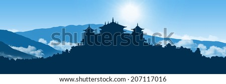 a traditional Tibetan Buddhist monastery on the hill covered with vegetation, Himalayas landscape on the background, large panoramic view - stock photo