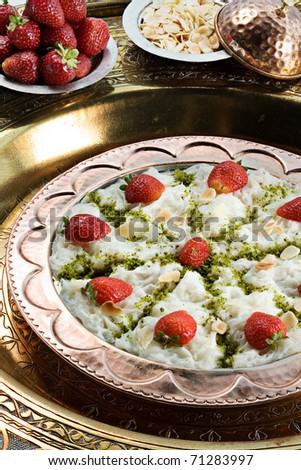 a traditional turkish  sweet made from sheets of dough made of starch soaked in milky syrup, filled with nuts and flavored with rose water