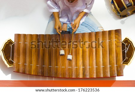 A traditional wooden Thai musical instrument, ranat ek, seen from directly above. It resembles a xylophone and is played with mallets. - stock photo