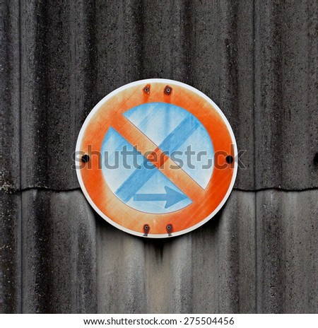 A traffic sign on a asbestos wall - stock photo