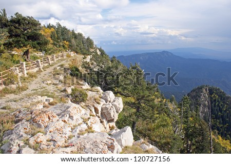 A trail along the edge of the Crest of the Sandia Mountains near Albuquerque, New Mexico in the early fall - horizontal orientation - stock photo