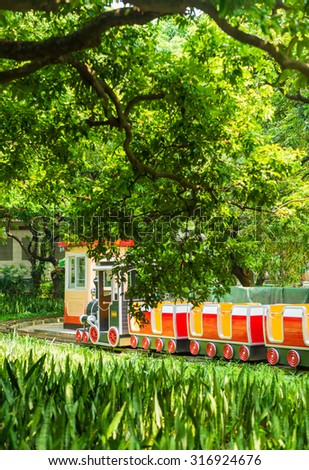 A train in the amusement park - stock photo