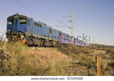 A train in the Karroo on the main railway line between Cape Town and Johannesburg in South Africa - stock photo