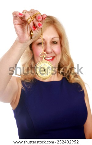 A trained Hypnotherapist puts You the viewer under her Hypnotic Spell as you gaze deeply onto the swinging gold watch. You are getting sleepy. You will buy this image. isolated on white  - stock photo