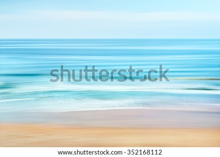 A tranquil seascape of the Pacific ocean off the coast of California.  Image features blurred water movement captured with a long exposure. - stock photo