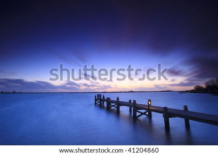 A tranquil sunset over a lake in the Netherlands - stock photo