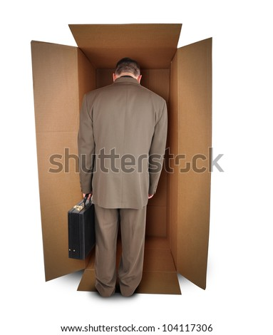 A trapped business man is walking into a brown box to represent a challenge or unemployment on a white background. The employee is wearing a suit. - stock photo