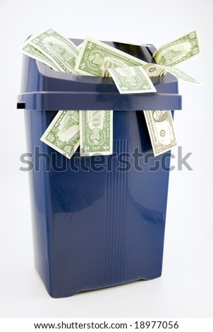 A trash with one and ten dollar notes.