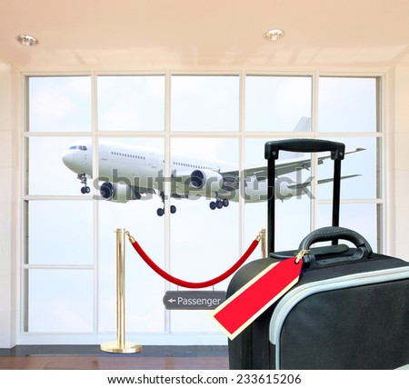 a traveler on a public or private conveyance other than the driver, pilot, or crew he is passenger explore the world with great white airplane in sky background and Black suitcase with blank label.  - stock photo