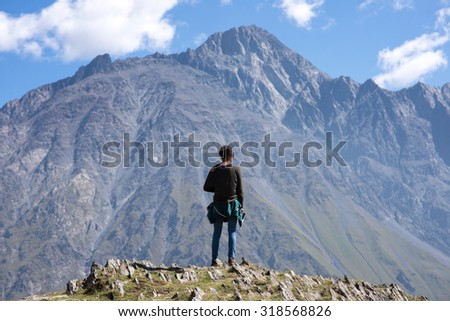 A traveler watching on mountain landscape, by Kazbeg mountain - Kazbegi (Stepantsminda), Georgia