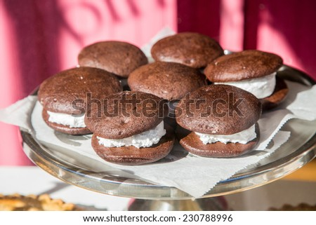 A tray of chocolate whoopie pies in a window display in Maine - stock photo