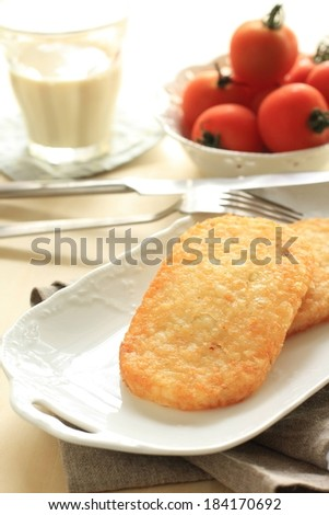 A tray of food with tomatoes and a drink beside it. - stock photo