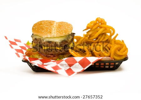 A tray with a Juicy Burger and with curly fries. - stock photo