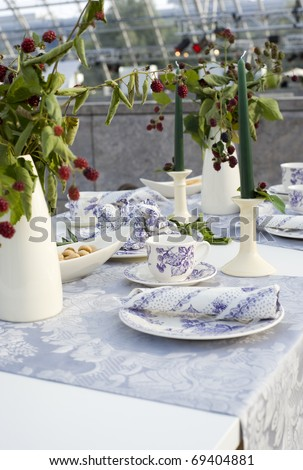 A trendy and beautiful decorated dining table setting. - stock photo