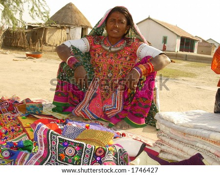 a tribal indian woman selling handicraft products - stock photo
