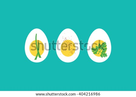 A trio of hard boiled egg horderves, with chives, paprika and parsley.  - stock photo