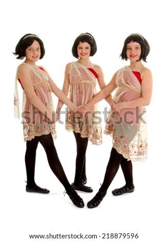 A trio of Three Irish Dancers in Recital Costume and Wigs - stock photo