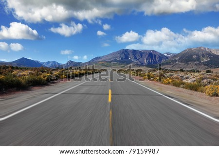 A trip at high speed through the colorful autumn desert to the distant mountains
