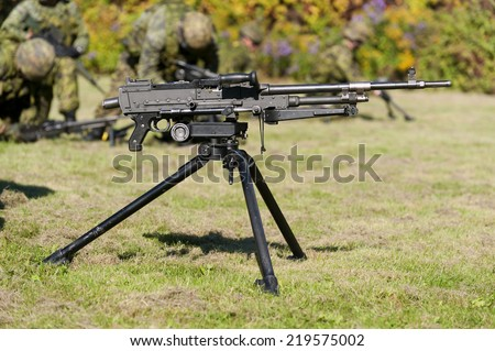 A tripod-mounted 7.62mm general purpose machine gun. - stock photo