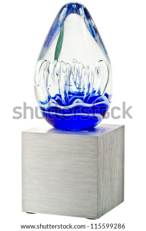 A Trophy with a Glass top with Multiple Patterns and a Silver Metal Base - stock photo