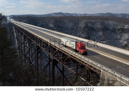 A trucker drives across The New River Gorge Bridge in Fayetteville, West Virginia.