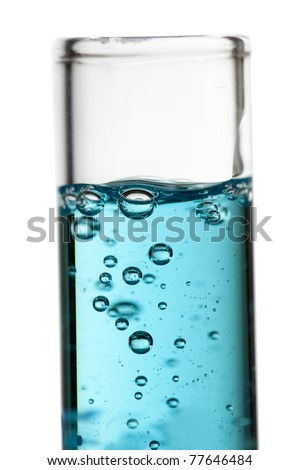 A tube with blue liquid and bubbles. - stock photo