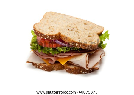 A turkey sandwich on multigrain bread with lettuce, tomato, Cheese and onions on a white background - stock photo
