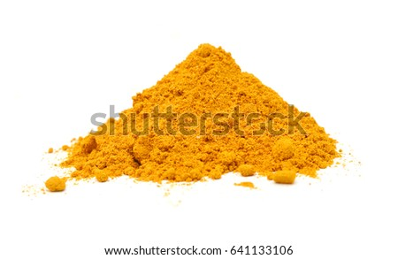 A turmeric powder pile on white