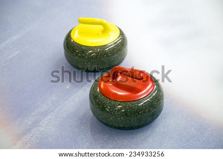 A two curling stone on the ice of a curling rink - stock photo