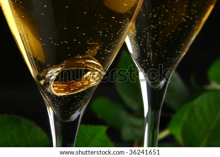 a two glasses of champagne with the ring inside - stock photo