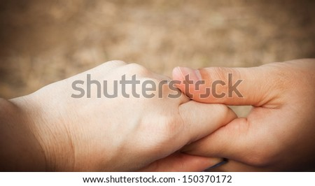 a two hands of a loving couple - stock photo