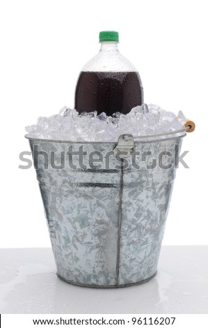 A two liter cola soda bottle in a metal bucket full of ice on a wet countertop. Vertical format over a white background. - stock photo