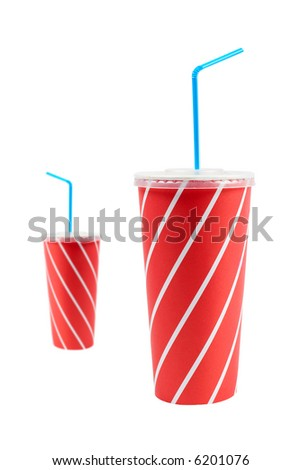 A two soda drinks with blue straw, isolated on white background. Focus at front - stock photo