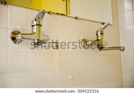 a two water taps in the bathroom - stock photo
