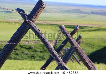 A type of fence known as a buck fence or jackleg fence. - stock photo
