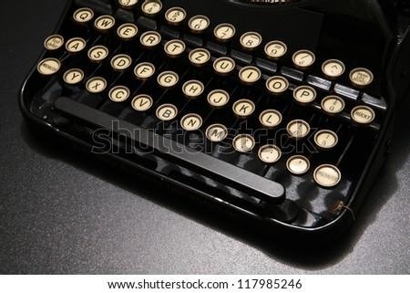 a typewriter in dramatic lighting. - stock photo