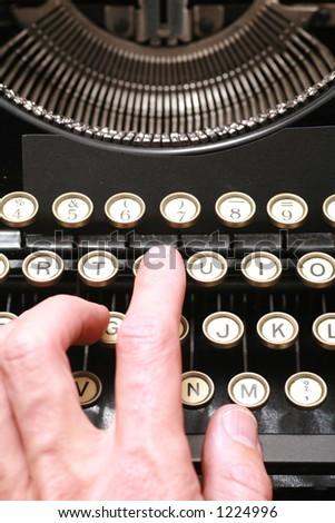 a typewriter in dramatic lighting - stock photo
