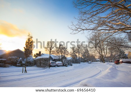 A typical American street as the sunrises after a winter storm - stock photo