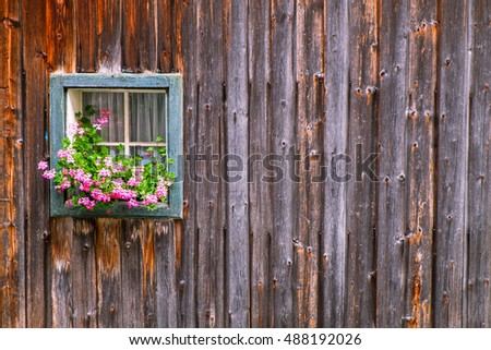 A typical Austrian farmhouse window in alps