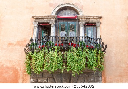 A typical decorative balcony in the old town of  lake Garda Italy - stock photo